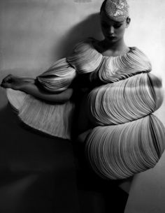 Wearable Art - cape-like dress with structural layered construct using circles of fabric to create a striking 3D design; sculptural fashion // Valentino