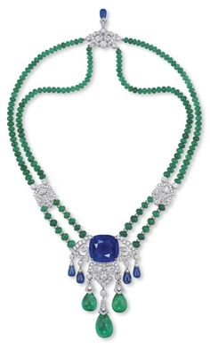 A SAPPHIRE, EMERALD AND DIAMOND PENDENT NECKLACE/BROOCH, BY CARTIER. DESIGNED AS AN OPENWORK BRILLIANT-CUT DIAMOND GIRANDOLE PENDANT, SET TO THE CENTRE WITH A CUSHION-SHAPED SAPPHIRE SUSPENDING GRADUATED SAPPHIRE AND EMERALD DROPS, TO THE DOUBLE-STRAND EMERALD BEAD NECKCHAIN WITH DIAMOND ROUNDEL ACCENTS, JOINED AT INTERVALS BY BRILLIANT-CUT DIAMOND STYLIZED LINKS, THE CLASP FURTHER ENHANCED BY A SAPPHIRE DROP MOUNTED IN PLATINUM  SIGNED CARTIER, NO. 34391B