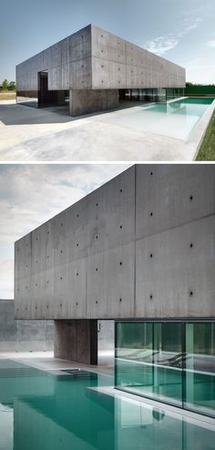 13 Modern House Exteriors Made From Concrete   This box-like concrete home sits on top of a base of windows that make it look like it's hovering next to the blue pool.