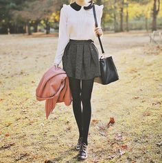 peter pan collar, black tights, skirt.