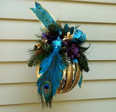 Christmas ornament, Gold striped ball,  teal/ blue PEACOCK, Peacock feather print bow, evergreens. $50.00, via Etsy.