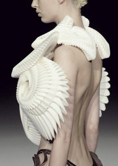 3D printed fashion with sculptural fossil like structure - fashion architecture; wearable art // Iris van Herpen
