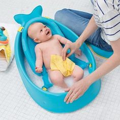 The Skip Hop Moby Smart Sling 3 Stage Bath Tub is a versatile bath tub that grows with your baby through three stages and is the only baby bath tub you'll ever need. The sling locks into two ergonomic positions; higher for full-body support and lower for Baby Bath Seat, Baby Tub, Boy Bath, Baby Needs, Baby Love, Baby Lernen, Bed Wetting, Everything Baby, Baby Hacks