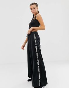 Buy Reebok Training Wide Leg Trousers In Black at ASOS. With free delivery and return options (Ts&Cs apply), online shopping has never been so easy. Get the latest trends with ASOS now. Gym Wear For Women, Active Wear For Women, Pants For Women, Wide Leg Trousers, Wide Leg Pants, Black Pants, Curve Leggings, Reebok Training, Gym Clothes Women