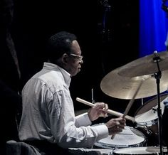 """Hard Bop was at the forefront of jazz and went through its most concentrated growth and development from 1951–1958.   Hard bop is undeniably Afro-centric.    As in all major northern cities, New York experienced an increasing African American population, making it an ideal backdrop and fertile breeding ground for hard bop."""" J. KENT WILLIAMS, The New Grove Dictionary of Jazz"""