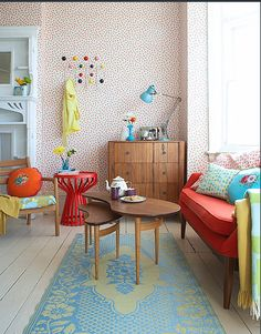 Playful colors & patterns mixed with vintage furniture & traditional architecture. Stunning fun combination!