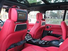 2014 Land Rover Range Rover Autobiography. Rear seat. Notice the speakers on the backs of the front seat. Each one houses 3 speakers. The total speaker count in this SUV is 29, including 4 roof-mounted speakers. A total of 1,700 watts. Not too shabby.