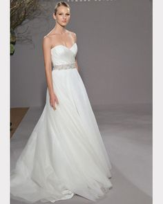 Legends by Ramona Keveza's beautiful ball gown features a strapless draped neckline made of silk organza spilling into a flowing skirt made of soft net.  Available at Brides By The Falls in Chagrin Falls, Ohio.