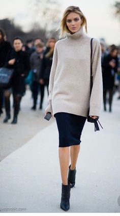 Oatmeal colored sweater, black skirt and black shoes for fall capsule wardrobe.