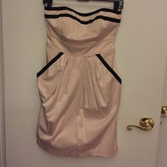 Light pale pink with black trim strapless dress Strapless dress, very pale light pink (almost cream) with black detailing, adorable pockets!!, and satin band that ties around the back, wore one time to a wedding, size 7, price negotiable Dresses Strapless