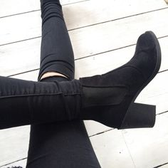 Pair a black skinnies with black boots to create the illusion of longer legs.