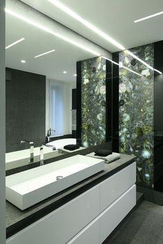 Legionowo House by Nasciturus Design.  I think the inlay in the wall is mother of pearl.  Beautiful.  It invokes nature.