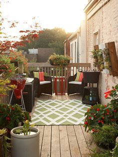 Love this seating area surrounded by flowers
