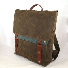 Hey, I found this really awesome Etsy listing at http://www.etsy.com/listing/103059799/scout-waxed-canvas-backpack