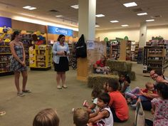 """Center, Nicolle Oppenheimer community business development manager for the Bridgewater Barnes & Noble, welcomes young readers to the start of Saturday's Reading Triathlon celebration at the store. Among the guests was Hayley Pellis, right, with """"Wilbur"""" from """"Charlotte's Web."""" (Photo: Staff photo by Paul C. Grzella)"""