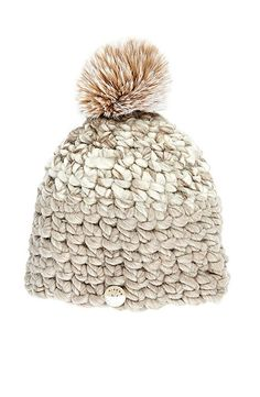 Mischa Lampert deep beanie in taupe: http://www.stylemepretty.com/living/2016/01/29/cute-cold-weather-accessories/: