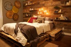 Rustic bedroom. Wood paneling, pallet bed.  __    Everything in the room is organic, reused, or some sort of renewable resource.  The floor is stained concrete.