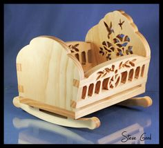 This is a small cradle for a 6 inch doll. The construction is slot and tab and butt joints for easy build. The side rails are raised to pre...