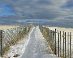 Old Orchard Beach, Maine.  The ocean is at the end of the walkway.