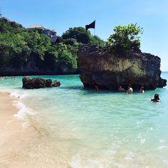 Clear blue waters of Padang Padang Beach, Bali.
