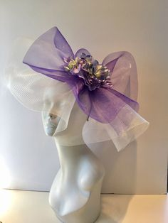 A personal favorite from my Etsy shop https://www.etsy.com/listing/499479946/purple-fascinator-flower-hat-derby