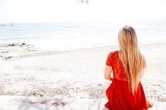 Beautiful girl portrait. Girl in red dress. Nature portrait.