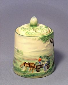 """Lovely Maratomo honey or mustard pot with country scene showing a tree, horse and cart and farmers Lid has decoration and a small finial knob to top Small cut out in lid for spoon Stamped to base with Marutomo symbol T in a circle and """"foreign"""" Antiques Online, Country Scenes, Cooking Utensils, Porcelain Ceramics, Knob, Farmers, Bees, Spoon, Mustard"""