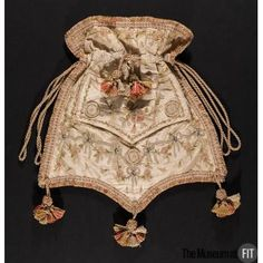Embroidered silk reticule. French, c. 1800. Women's dresses of the early nineteenth century were too simple and lightweight to have pockets; consequently, charmingly-embellished bags became indispensable accessories. This reticule was made from an eighteenth-century man's waistcoat. Elaborate waistcoats had gone out of fashion, but the one used here had been saved, probably because of its striking embroidery. --Fashion Museum FIT NY