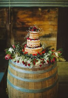 rustic naked wedding cake on wine barrel