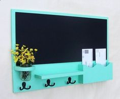 Chalkboard, mail station, key holder all in one. So easy to DIY and paint whatever color matches your room.