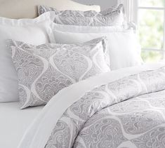 This is a gorgeous option.  You can get teal sheets and some throw pillows and a throw in shades of teal or red or orange.  Jenna Shimmer Duvet Cover & Sham | Pottery Barn