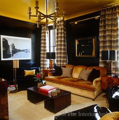 The library is strikingly decorated with black panelled walls and a yellow ceiling set off by black and yellow striped curtains ~ Steven Gambrel design