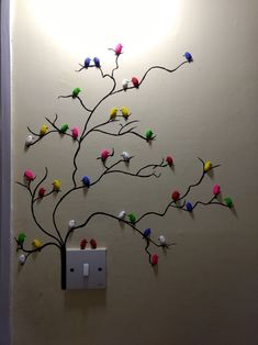 Room decoration with pistachios. #wallart #tree #birds #colors #switch