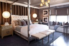 : Transitional Brown Themed Bedroom Suite For Men Furnished With Mirrored Canopy Bed And Modern Chandeliers