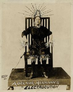 Photograph of Adelaide Herrmann's Electrocution illusion. New York, Repro Photo, ca. 1910. Unusual image of Adelaide Herrmann seated in an electric chair, retouched to show sparks flying from her body