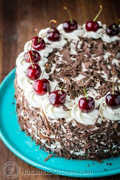 This Black Forest Cake is a famous German chocolate cake. It has 4 chocolatey layers, 1 lb of kirsch infused cherries and a light whipped cream.: