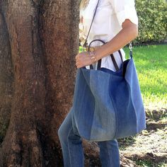 Reduce, Recycle and Reuse! Made from two pairs of recycled denim jeans, this large striped tote bag can be used as a farmers market tote bag, summer beach bag or for everyday. Bag is lined with a beig
