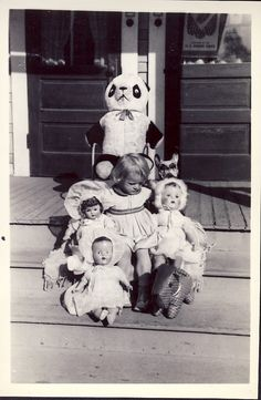 There's my old teddy bear! Sweet 1950's photo of girl with her dolls and stuffed animals.