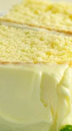 """Lemon Drop Cake with Lemon Frosting ~ """"Poked"""" with a Fork and Pouring Sweetened Lemon Juice over this Cake is a Delicious Secret ingredient."""