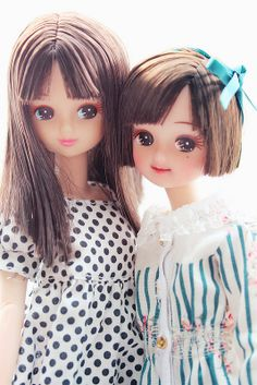 Jenny dolls from Japan. The hair while not in keeping with the Regency, is beautiful. The polka dot dress is empire line, although the print is not. I like them very much.