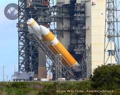 ULA Delta IV Heavy Rocket Rolled to Cape Launch Pad and Raised for Orion's First Flight