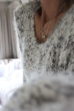 V-neck thick knit gray marled sweater multiple delicate necklaces classic chic timeless