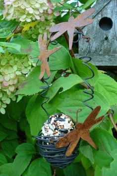 I like the idea of twisted wire to hold the suet cake.