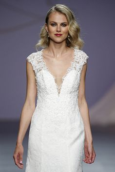 Leave your fiancé speechless in this plunging neckline wedding dress!   Justin Alexander