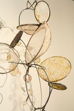 """Rickie Wolfe  detail ofinstallation, metal, wire, paper, fiber, wax, 2009  90""""H x 99""""W"""