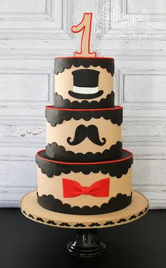 Lil' Man 1st Birthday Cake - I loved the concept of this design, before I even started on it. Such a fun way to play around with this. Cakes are covered in MMF and hat, mustache and bow tie are cut from fondant. TFL