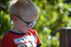 L1M2AP1 Nikon D5100, Aperture mode, going for shallow DoF, f/5, ISO 160, 1/160 shutter speed, 145mm focal length, took this photo of Angus at the park today, he was just in his own world, contemplating who knows!! This shot was taken in open shade, using rule of thirds and was handheld.