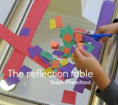 The reflection table. Love this idea for cutting and other typical activities made more interesting with a mirror!