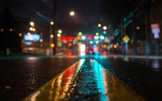 """This is an image of a street at night, using a close-up bokeh effect. Bokeh is an effect in photography; it is """"the visual quality of the out-of-focus areas of a photographic image, especially as rendered by a particular lens."""