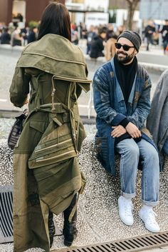 The scene outsidePitti Uomo is always a feast for the eyes. We love seeing how these dapper dudes manage tolayer and accessorize their winter looks to perfection. And kudos to the ladies, who show that they, too, can play at theirgame . . .